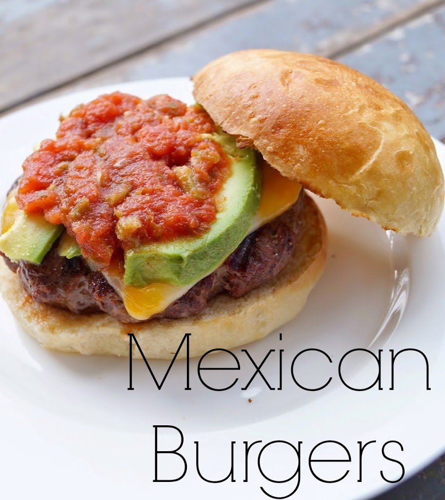 Mexican Burgers topped with avocado slices, fresh salsa, all put on a delicious homemade brioche bun!