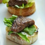 Balsamic Beef Crostini with Herbed Cheese and Arugula