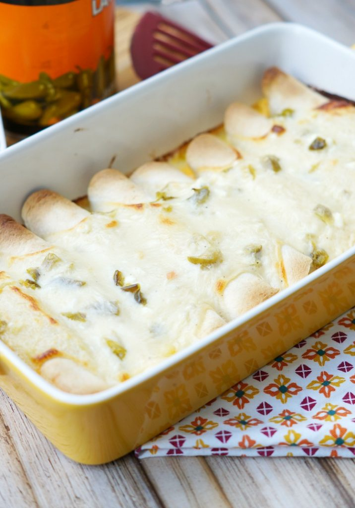 Creamy Jalapeno Queso Chicken Enchiladas