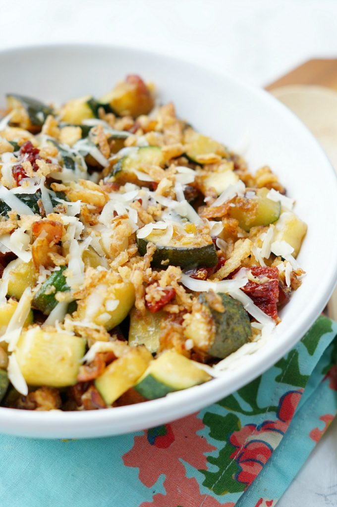 Zucchini with Sun Dried Tomato, Bacon, and Crispy Onions